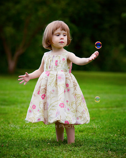 Little girl with bubbles portrait