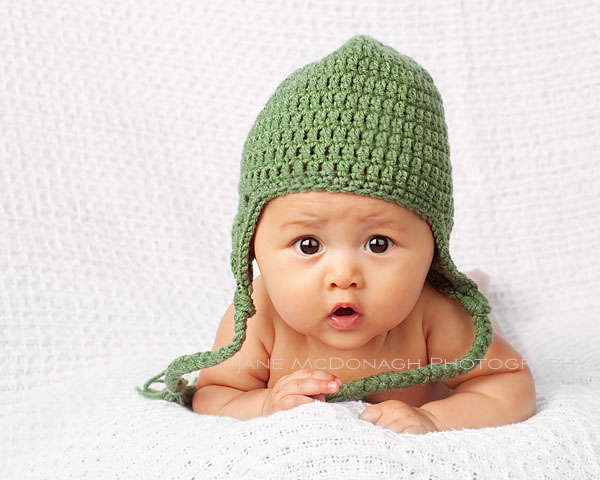baby wearing green hat