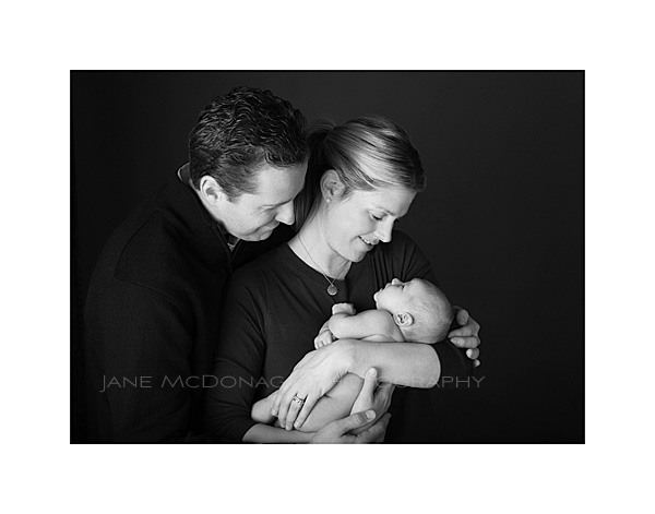 2 week old baby portrait with parents