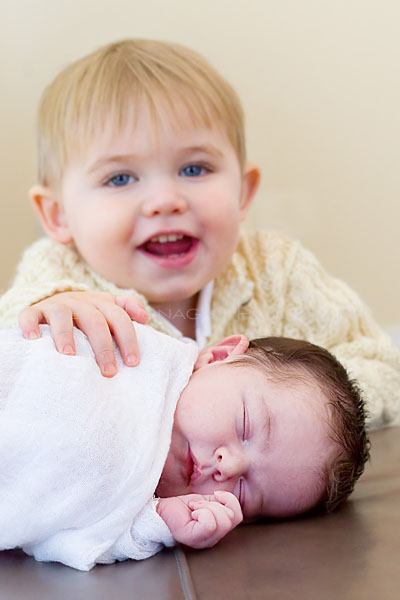 Newborn portrait with sibling